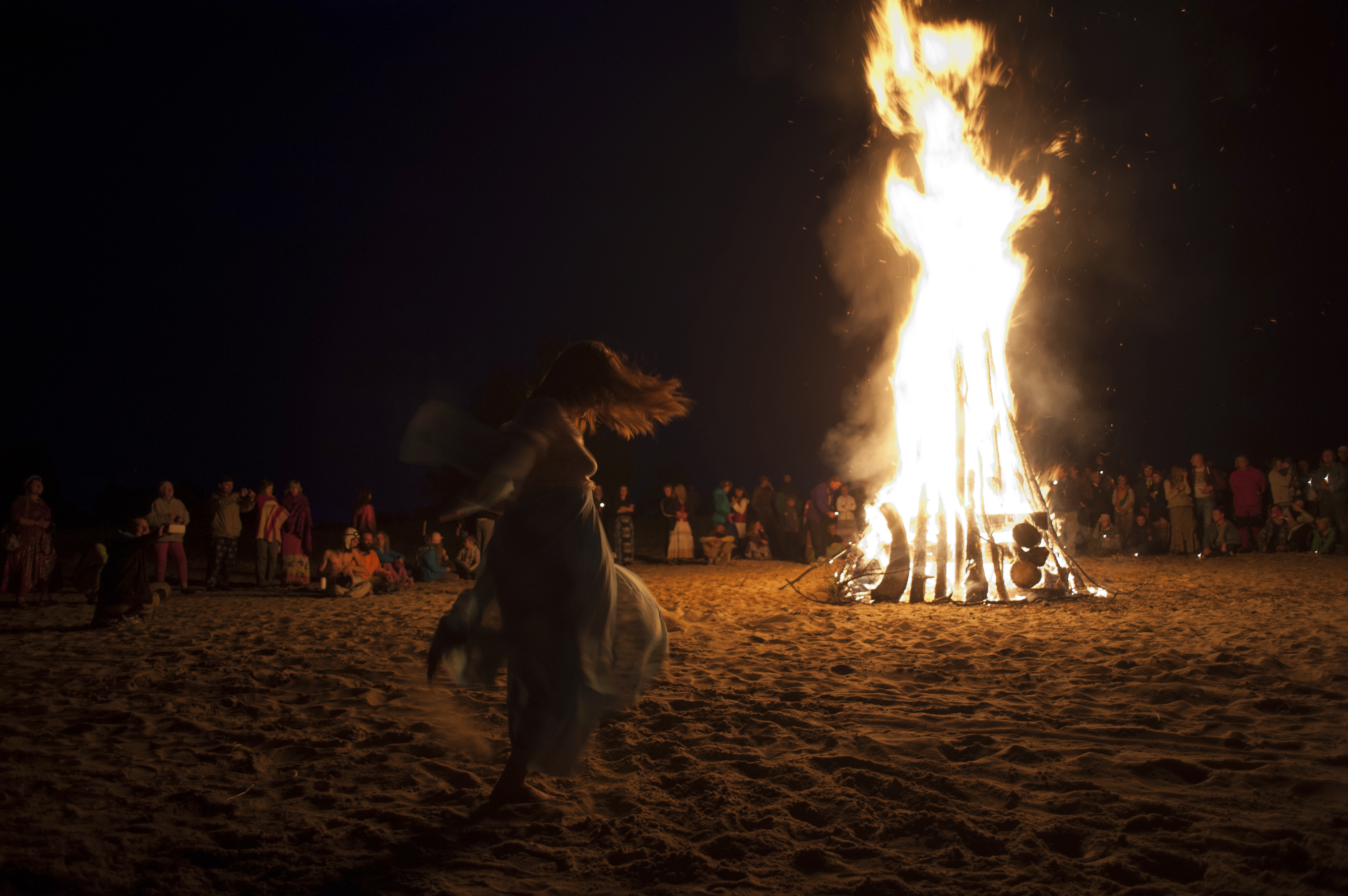 woman dancing bonfire